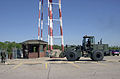 188th Fighter Wing, Arkansas Air National Guard, Fort Smith, Arkansas, an unidentified civil engineering state employee uses a John Deere 644E-H forklift to deliver concrete barriers to front gate shortly after 010911-F-EF792-001.jpg