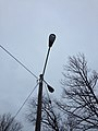 2014-12-20 16 26 31 Sodium vapor and mercury vapor street lights before being turned on along an alley adjacent to Winthrop Avenue in Ewing, New Jersey.JPG