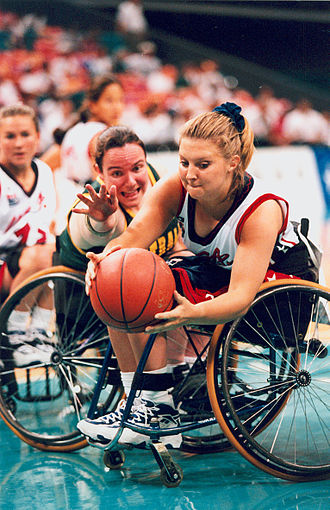 Wheelchair basketball - Australian women's wheelchair basketballer Amanda Carter challenging for the ball in a game against the USA at the 1996 Atlanta Paralympic Games