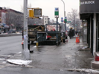 53rd Street (BMT Fourth Avenue Line) - The entrance at 4th Avenue and 53rd Street prior to renovation, seen during a snowy day. This entrance is located next to a bus stop.