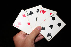 The fives of all four suits in playing cards