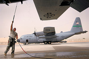 332d Expeditionary Operations Group - 777th Expeditionary Airlift Squadron C-130 Hercules at Balad AB Iraq getting a power wash of the engines to ensure that built up dust does not get pulled into the intake during flight.
