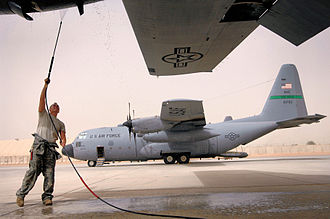 Balad Air Base - 777th Expeditionary Airlift Squadron C-130 Hercules at Balad AB Iraq getting a power wash of the engines to ensure that built up dust does not get pulled into the intake during flight.