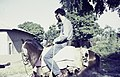 ASC Leiden - Rietveld Collection - Nigeria 1970 - 1973 - 01 - 014 Toro College. Rietveld receives horse riding lessons in front of a house - Toro.jpg