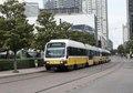 A DART (Dallas Area Rapid Transit) light-rail train passes in downtown Dallas, Texas LCCN2014633019.tif