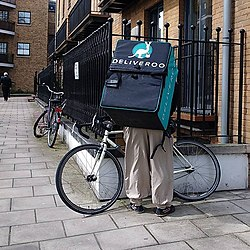 A Deliveroo cyclist in London, UK.jpg