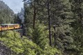 "A Durango & Silverton Narrow Gauge Railroad (D&SNG) train proceeds along the rocky ""Highline"" ridge high above the Animas River Valley in La Plata County, Colorado LCCN2015632948.tif"