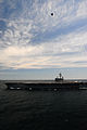 A U.S. Navy X-47B Unmanned Combat Air System demonstrator aircraft flies over the aircraft carrier USS George H.W. Bush (CVN 77) May 14, 2013, in the Atlantic Ocean 130514-N-XE109-566.jpg