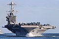 A U.S. Navy aircraft carrier transits the Atlantic Ocean. (25297093017).jpg