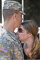 A U.S. Soldier, left, with the 147th Finance Company, 347th Regional Support Group prepares to leave Roseville, Minn., Sept 120905-A-TH293-512.jpg