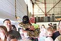 A U.S. Soldier with Golf Company, 2nd Battalion, 135th Aviation Regiment, Kansas Army National Guard greets a loved one during a homecoming ceremony Sept 140907-Z-VX744-658.jpg