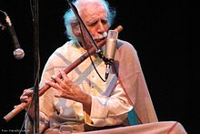 A man playing bansuri