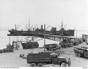 Allied logistics in the Kokoda Track campaign - A cargo ship being unloaded at the wharf in Port Moresby in August 1942