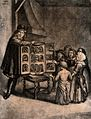 A man has an open box with figures in it resting on a chair, Wellcome V0040134.jpg