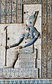 A relief in the Hathor Temple at Dendera shows Horus of Edfu, sitting on a throne and wearing the combined crowns of Upper and Lower Egypt.jpg