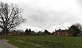 A view towards houses and church from east, at Tilty, Essex, England.jpg