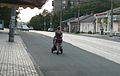 A walk with a pram. She goes means busy street.JPG