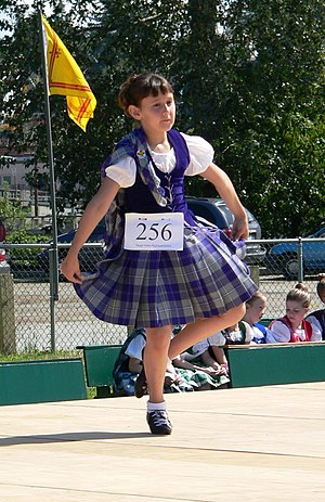 Aboyne dress - A young Highland dancer wearing the Aboyne dress prescribed for female dancers for the National dances.