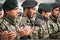 Afghan National Army soldiers pray during a ribbon-cutting ceremony marking the opening of the Fires Center of Excellence, a field artillery training center at Camp Eagle in Zabul province, Afghanistan, Dec. 30 131230-Z-HP669-001.jpg