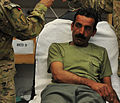Afghan policeman helped by SFAT, FST 121213-A-BF245-231.jpg