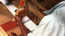 File:Akan Kente clothing tailor preparing Kente attire (Video).ogv