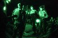 An Afghan officer, center, prepares to lead a night mission during Operation Shamshir, in the Kharwar district of Logar province, Afghanistan, Oct. 17, 2011 111017-A-ZI978-003.jpg