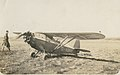 Arthur Butler and the Comper Swift aeroplane G-ABRE in field, 1931 (4).jpg