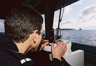 Officer cadet - An officer cadet (an « aspirant ») of the French Navy (wearing his rank shoulder strap) taking a naval measurement on the board of the patrol boat Cormoran..