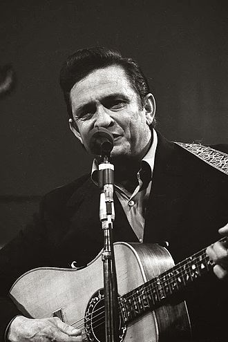 Man in Black (song) - Cash in black at his legendary 1969 performance at San Quentin