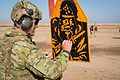 Australian army trainer marks an Iraqi security forces soldier's firing group during a familiarization range at Camp Taji, Iraq.jpg