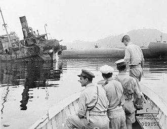 Attack on Yokosuka - Royal Australian Navy personnel inspecting a wrecked submarine and a wrecked ship at Yokosuka during September 1945