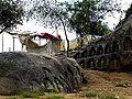 Barabar Caves - Lingas Carved in Rock near Peak (9227545770).jpg