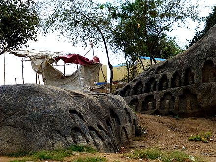Barabar Caves - Lingas Carved in Rock near Peak (9227545770).jpg