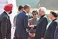 Barack Obama and the First Lady Mrs. Michelle Obama being welcomed by the Minister of State (Independent Charge) for Corporate Affairs and Minority Affairs, Shri Salman Khurshid, on their arrival (1).jpg