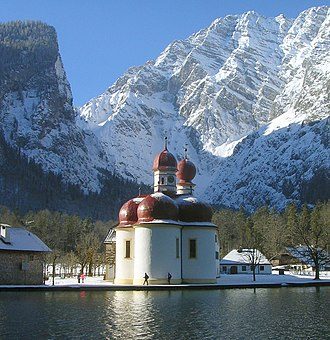 Watzmann East Face, rising behind St. Bartholomew's church at lake Konigssee Bartholomae-2005.jpg