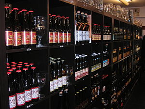 Beer shop - Bottles of beer and glassware at a beer shop