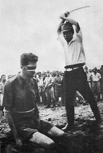 An Australian POW, Sgt. Leonard Siffleet, captured in New Guinea, about to be beheaded by a Japanese officer with a gunto, 1943 LeonardGSiffleet.jpg
