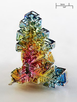 Bismuth - Bismuth crystal illustrating the many iridescent refraction hues of its oxide surface