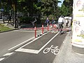 Bikes turn left to get from traffic circle to median bikeway (17926346474).jpg