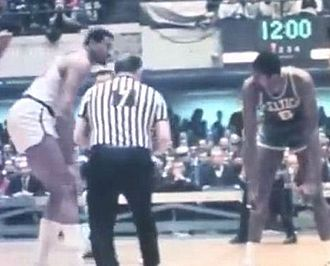 Norm Drucker - Norm Drucker ready for the center jump between the Philadelphia 76ers' Wilt Chamberlain (left) and the Boston Celtics' Bill Russell, to start the deciding game of the 1967 NBA Eastern Conference finals. The 76ers won and ended the Celtics string of eight consecutive NBA championships.