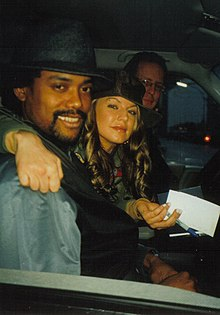 Fergie with fellow Black Eyed Peas member apl.de.ap.