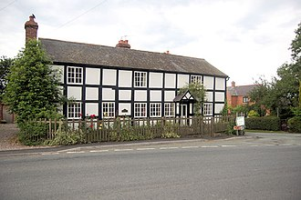 Chirbury - Historic black-and-white cottages at the junction with the road to Montgomery.