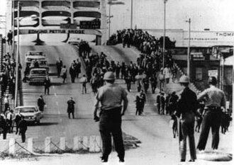 Selma to Montgomery marches - Police watch marchers turn around on Tuesday, March 9, 1965.