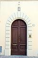 Borgo san lorenzo, portale con stemma innocenti.JPG
