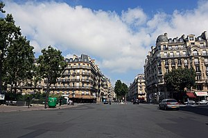 Sèvres – Babylone (Paris Métro) - Boulevard Raspail crossing Rue de Sèvres and Rue de Babylone. Sèvres-Babylone Metro Station at the left