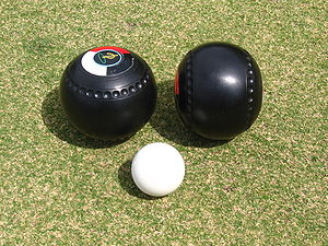 Two lawn bowls and the kitty (or jack)