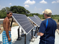 Brad Mattson installing solar panels in an off-grid Indian village, June 2013 .png