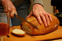 Breaking bread, juice, dinner party, Broadview townhouse, Seattle, Washington, USA.jpg