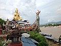 Buddha statue seated on a treasure ship.jpg