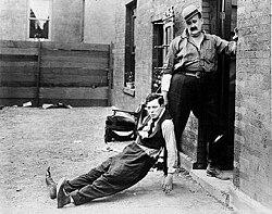 Buster Keaton (left) and Joe Roberts in the movie Neighbors (1920).jpg